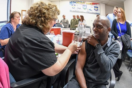 Chris Redmond, with the Aerospace Enabler Division at the Air Force Life Cycle Management Center, gets his flu shot from registered nurse Mary Piersanti, Davis County Health Department. Flu shot clinics are still being held at various locations on Hill Air Force Base until Nov. 15 for Hill personnel. (U.S. Air Force photo by Cynthia Griggs)